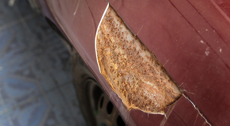 Rusty On Red Car. Crack Of Car Paint